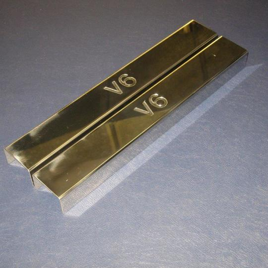 Polished stainless steel covers for front chassis cross member on...