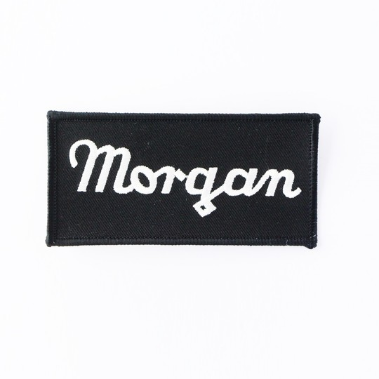 Embroidered Morgan script badge (white on black)