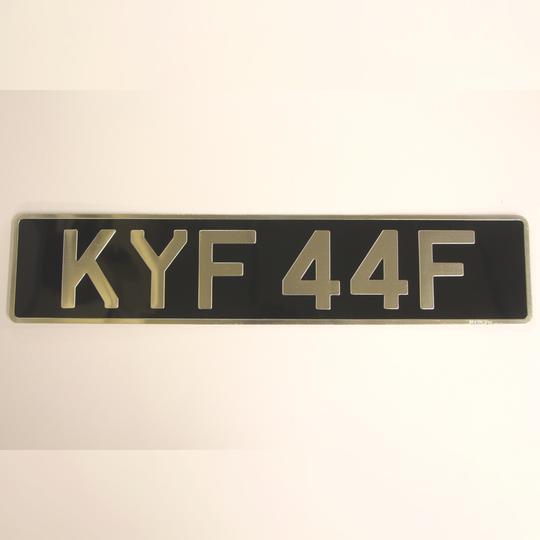 Single original pressed alloy number plate - oblong