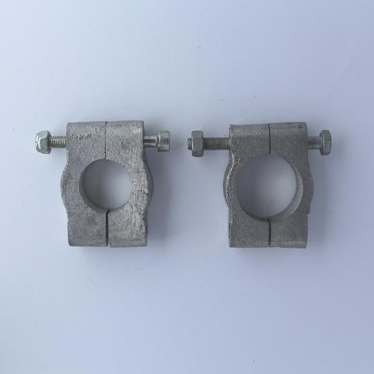 Tie clamp for solid steering column (upper)